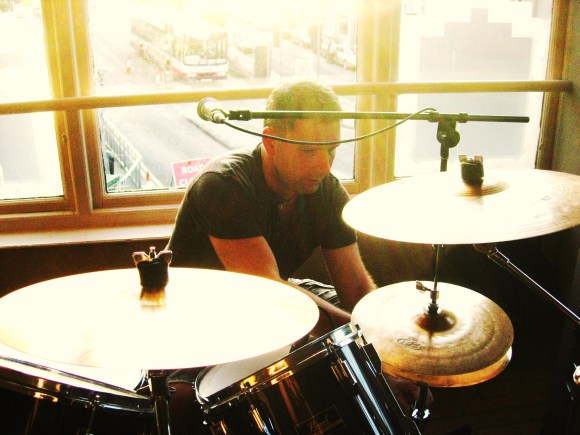 Derek setting up the kit for Tonight Live Not Completely Sold Out