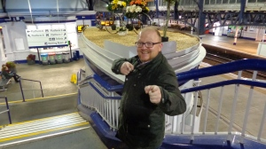 Byrne poses in front of the strange decorations at Stirling station.