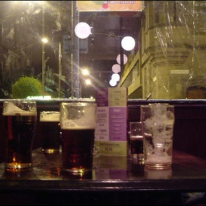 Drinks on the cover and drinks in the album. This is a wee table in the quiet corner of Firkins